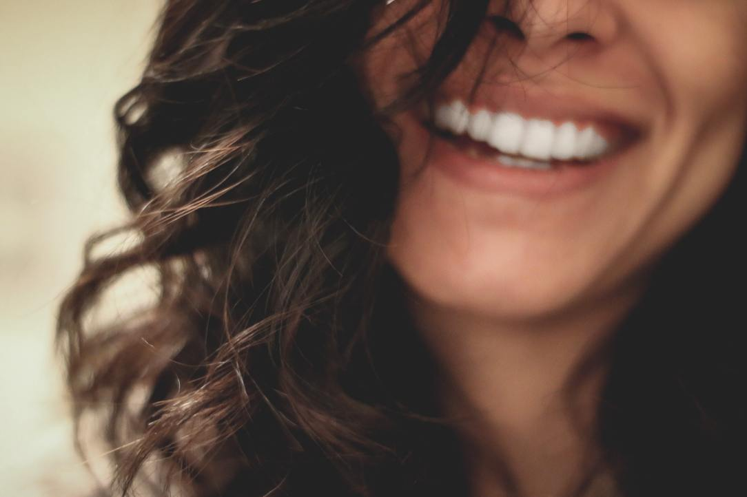 An image of a smile via Lesly Juarez on Unsplash