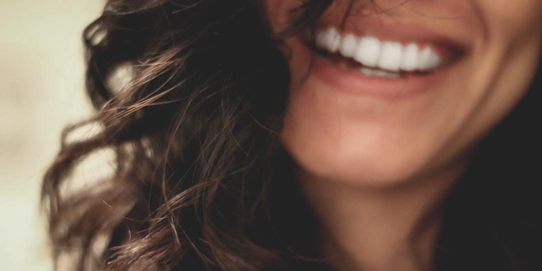 An image of a smile via Lesly Juarez on Unsplash