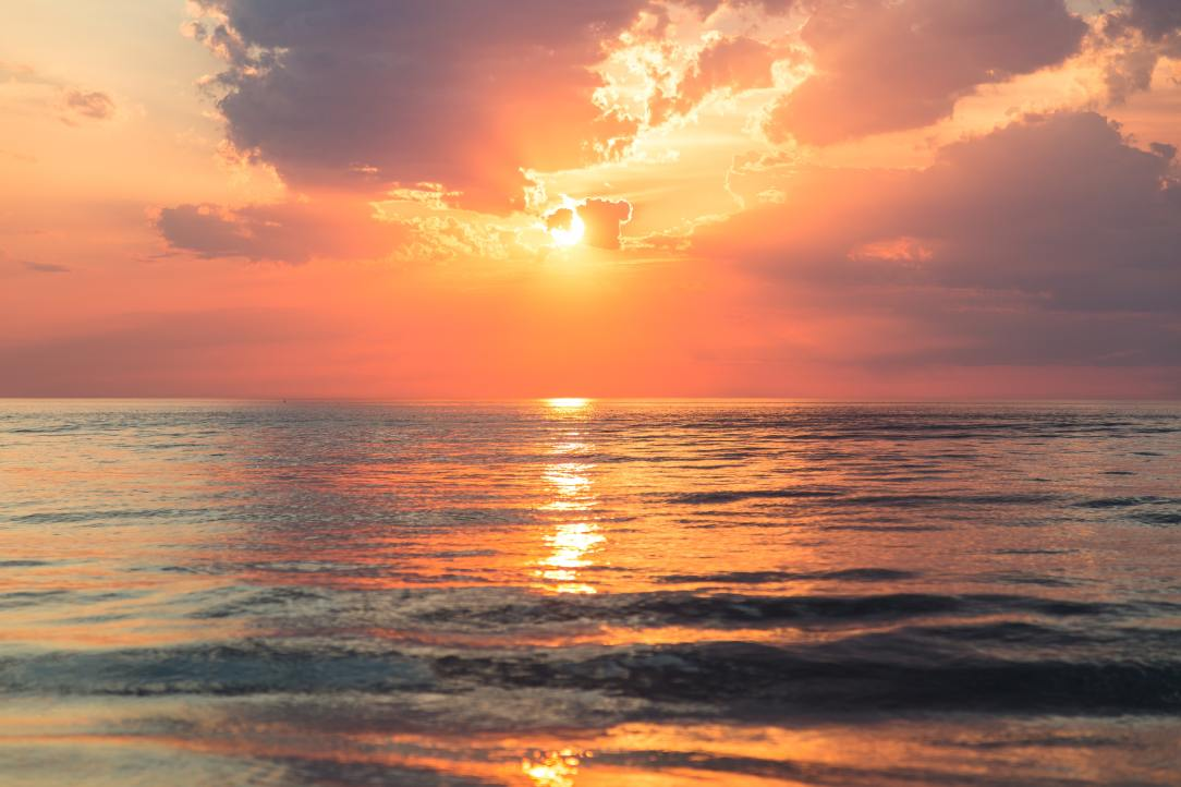 A picture of a sunset over the ocean.